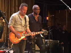 David Sancious and Bruce Springsteen playing guitar on stage