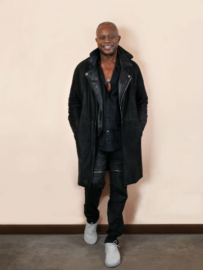 David Sancious standing against the wall smiling