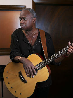 David Sancious holding acoustic guitar
