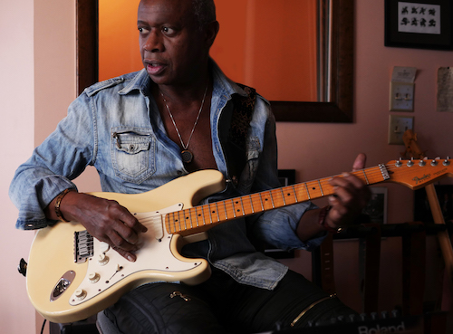 David Sancious sitting down playing guitar