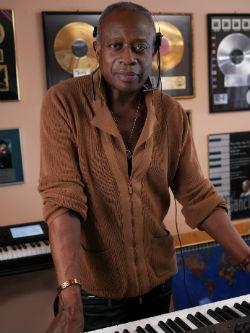 David Sancious in studio with records behind him