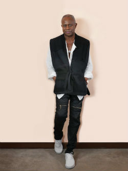 David Sancious in a vest standing